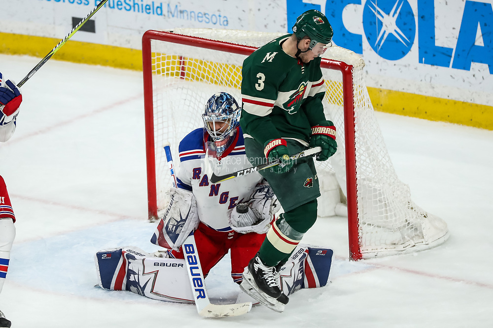 Feb 13, 2018; Saint Paul, MN, USA; New York Rangers goalie Henrik Lundqvist (30) makes a save in front of Minnesota Wild forward Charlie Coyle (3) during the third period at Xcel Energy Center. Mandatory Credit: Brace Hemmelgarn-USA TODAY Sports