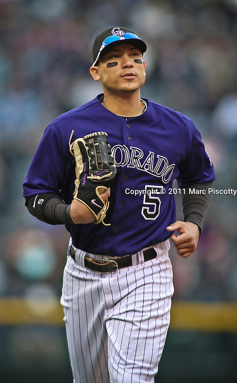 SHOT 4/20/11 3:24:22 PM - Colorado Rockies left fielder Carlos Gonzalez takes the field against the San Francisco Giants during their game at Coors Field in Denver, Co. The Rockies won the game 10-2 and avoided a sweep in the series after the Giants had taken the first two games. (Photo by Marc Piscotty / © 2011)