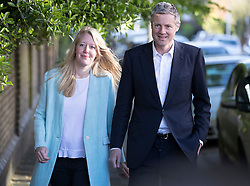 © Licensed to London News Pictures. 05/05/2016. London, UK.  Conservative candidate for London Mayor Zac Goldsmith arrives with his wife Alice after to cast his vote in his Richmond Park constituency. Voting is taking place today for the Scottish Parliament, the Welsh Assembly, the Northern Ireland Assembly, local council elections in England, Mayor of London and London Assembly, Police and crime commissioner and two Westminster by-elections. Photo credit: Peter Macdiarmid/LNP