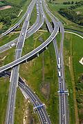 Nederland, Noord-Brabant, Eindhoven, 27-05-2013; Randweg Eindhoven. Knooppunt De Hogt, verkeersknooppunt, aansluiting autosnelweg A2 en autoweg N2 op de A67. Foto in oostlijke richting, met kenmerkende fly-overs, ook over het riviertje De Dommel. <br /> View on traffic junction De Hogt near Eindhoven, A67 connecting one of the main motorways of the Netherlands: A2 and crossing the river Dommel. <br /> luchtfoto (toeslag op standard tarieven);<br /> aerial photo (additional fee required);<br /> copyright foto/photo Siebe Swart.