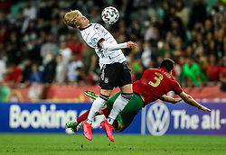 LJUBLJANA, SLOVENIA - JUNE 06: David Raum of Germany and Diogo Leite of Portugal battle for the ball  during the 2021 UEFA European Under-21 Championship Final match between Germany and Portugal at Stadion Stozice on June 06, 2021 in Ljubljana, Slovenia. Photo by Grega Valancic / Sportida