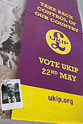 Nigel Farage, leader of anti-EU 'UK Independence Party's (UKIP), portrayed as Hitler on a political billboard showing an escalator leading up the white cliffs of Dover (a metaphor for unrestricted immigration access to Britain) in East Dulwich - a relatively affluent district of south London. The ad is displayed before European elections on 22nd May and UKIP's controversial right-wing policy of no foreigners into the UK to take British jobs, is promising to do well in the forthcoming election.