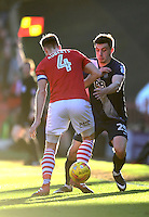 Preston North End's Jordan Hugill vies for possession with Barnsley's Marc Roberts<br /> <br /> Photographer Chris Vaughan/CameraSport<br /> <br /> The EFL Sky Bet Championship - Barnsley v Preston North End - Saturday 4th February 2017 - Oakwell Stadium - Barnsley<br /> <br /> World Copyright © 2017 CameraSport. All rights reserved. 43 Linden Ave. Countesthorpe. Leicester. England. LE8 5PG - Tel: +44 (0) 116 277 4147 - admin@camerasport.com - www.camerasport.com