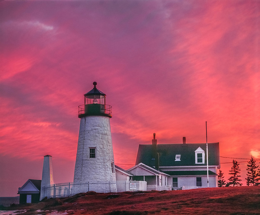 Pemaquid Point lighthouse and keepers house under magenta sky, Bristol, ME