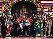 Hindu figures at start of 272 steps leading to Batu Caves with a Hindu Temple deep inside, Selangor, Malaysia.