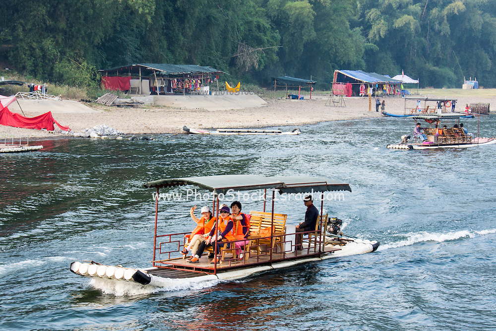 China, Yangshuo County, Bamboo rafts on the Yulong River Karst formations
