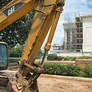 US Supreme Court Renovations with Digger. Renovations to the building of the US Supreme Court starting in the summer of 2012. This shot shows the workzone on the southern side of the building. In the background is the southern side of the main portico covered in scaffolding.