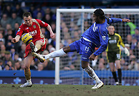 Photo: Lee Earle.<br /> Chelsea v Portsmouth. The Barclays Premiership. 25/02/2006. Portsmouth's Matthew Taylor (L) battles with Didier Drogba.