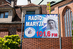 Radio Maria radio station poster outside cathedral Basilica of St. James the Apostle in Szczecin, Poland.