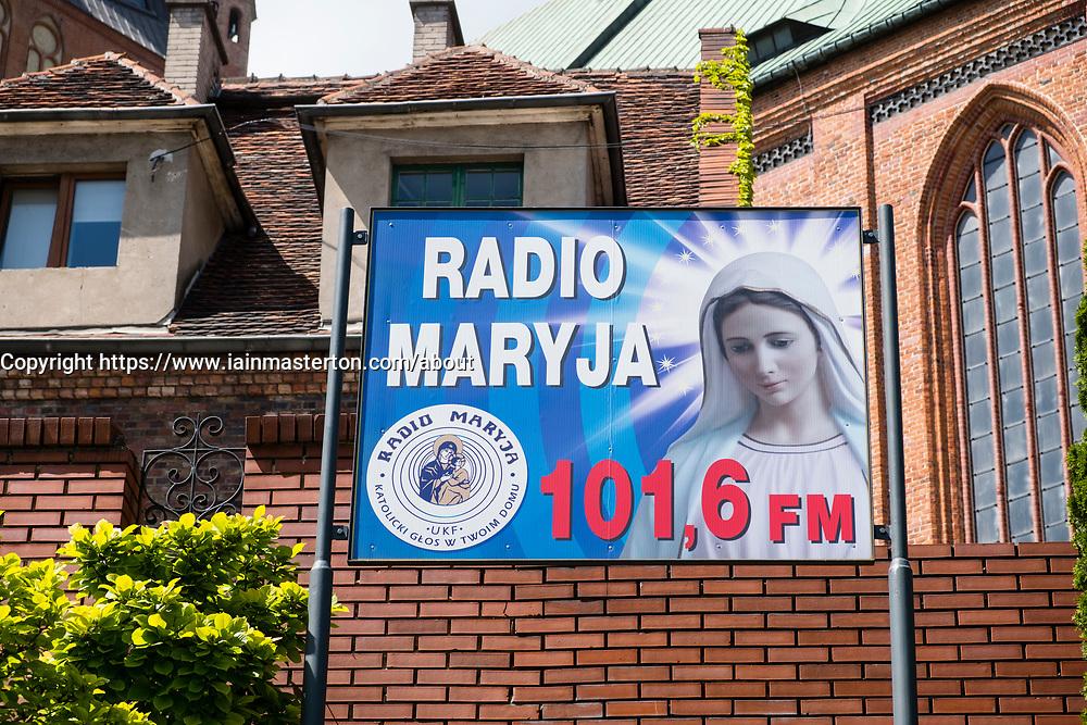 Radio Maria radio station poster outside cathedral Basilica of St. James the Apostle in Szczecin, Poland.