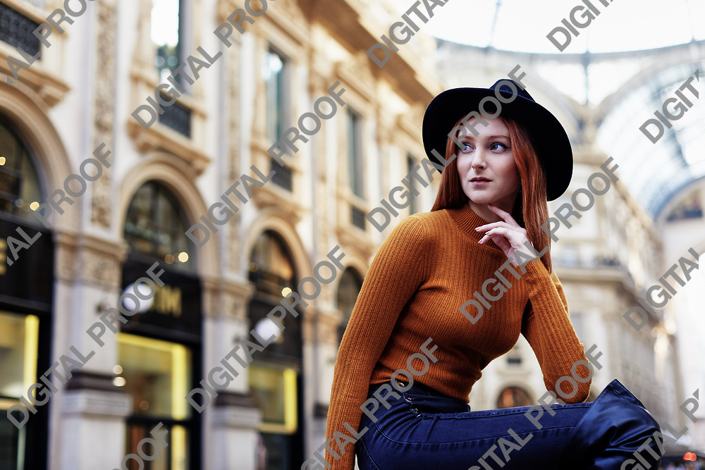 Woman pose for a portrait outside of the Galleria Vittorio Emanuele II in Milano Italy