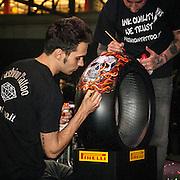 Motosalone Eicma edizione 2012: un pneumatico da gara decorato...International Motorcycle Exhibition 2012: a race tire decorated.