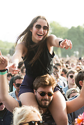 © Licensed to London News Pictures. 06/06/2015. London, UK.   A pretty girl dances on her boyfriends shoulders as they watch Kindness perform on stage at Field Day festival, day 1.   Photo credit : Richard Isaac/LNP