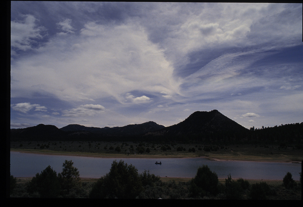 Showcasing the reservation's spectacular scenery, alpine highlands rise above the Wheatfield Lakes near Tsaile.
