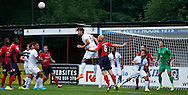 Julio Cesar with the headed clerance during the Pre-Season Friendly match between Hampton & Richmond and Crystal Palace at Beveree Stadium, Richmond Upon Thames, United Kingdom on 27 July 2015. Photo by Michael Hulf.