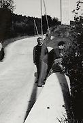 two men on a bridge in a rural environment 1950s France