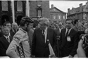 Nissan International Cycle Race..1986..01.10.1986..10.01.1986..1st October 1986..The Nissan Classic began today from Trinity College,Dublin. The offical race starter was The Taoiseach,Dr Garrett FitzGerald TD. He was accompanied by the Minister for Sport,Mr Sean Barrett TD..Sean Kelly was returning to defend his title but his opposition included Greg LeMond, the 1983 world champion and the winner of the Tour de France of the previous July. Roche was out due to his injured leg. Adri van der Poel was back with 1980 Tour de France winner and 1985 world champion Joop Zoetemelk. Teun van Vliet was back too. The winner of the green jersey of the Tour de France that July, Eric Vanderaerden was there as well as Australians Phil Anderson and Alan Peiper as well the Scottish cyclist Robert Millar...Image of An Taoiseach,Dr Garret FitzGerald,chatting with Sean Kelly.Mr Gerard O'Toole, Managing Director,Nissan Ireland, listens in