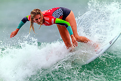 HUNTINGTON BEACH, CA - Stephanie Gilmore surfs at the quarter finals during the 2014 Vans US Open of Surfing.  2014 Aug 2. Byline, credit, TV usage, web usage or linkback must read SILVEXPHOTO.COM. Failure to byline correctly will incur double the agreed fee. Tel: +1 714 504 6870.
