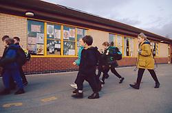 Junior school children arriving at school,