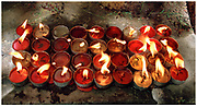Candles at the feet of Buddha Mahabodhi Temple Bodh Gaya India 2001