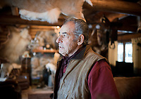 Eighty-one-year-old Pucci ran Crystal Creek Outfitters for nearly 40 years. His home near Hoback is adorned with animal pelts from his hunting days, and religious paraphernalia that reflects his deep Catholic faith.