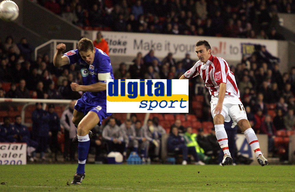 Photo: Paul Thomas.<br /> Stoke City v Millwall. The FA Cup. 05/01/2007.<br /> <br /> Peter Sweeney (R) of Stoke fires an early shot a goal just wide.