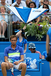 The umbrella which is meant to be shielding Russia's Daniil Medvedev opens the wrong way during day five of the 2017 AEGON Championships at The Queen's Club, London.