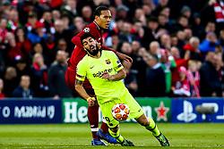 Luis Suarez of Barcelona takes on Virgil van Dijk of Liverpool - Mandatory by-line: Robbie Stephenson/JMP - 07/05/2019 - FOOTBALL - Anfield - Liverpool, England - Liverpool v Barcelona - UEFA Champions League Semi-Final 2nd Leg