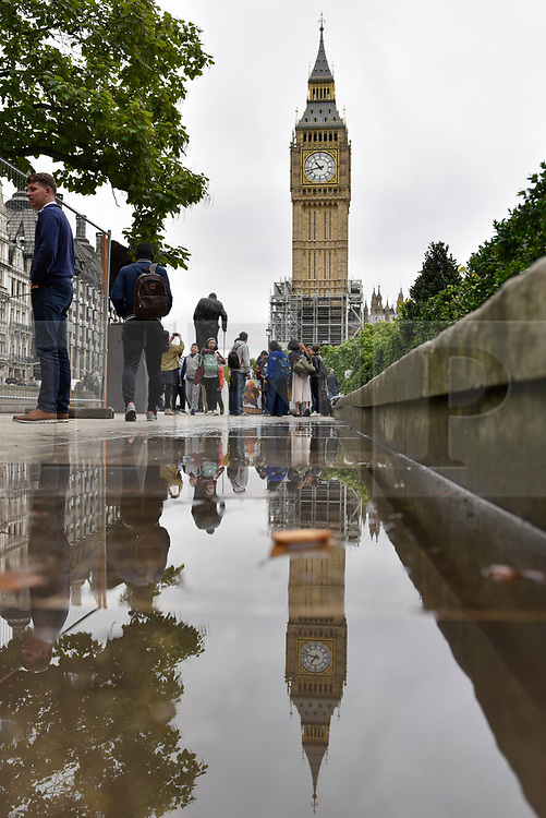 © Licensed to London News Pictures. 21/08/2017. London, UK. London, UK.  21 August 2017.  Crowds gather outside the Houses of Parliament to witness the last hourly chimes at noon of Big Ben, the bell inside the clock tower known as The Elizabeth Tower, ahead of four years of restoration work to the glass on the clock face, the hands of the clock and the tower itself.  One clock face will continue to show the correct time throughout the renovations, driven by a temporary electric motor.  It is planned that the clock will be restarted for Big Ben to chime at New Year, on Remembrance Sunday and other special occasions.  Photo credit : Stephen Chung/LNP