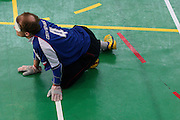 Goalball Spieler des tschechischen Teams Ivos Budil erwartet den Anwurf der gegnerischen Mannschaft während dem internationalen Turnier in Budapest. Goalball ist eine Mannschaftssportart für blinde und sehbehinderte Menschen und wurde vom Österreicher Hans Lorenzen und dem deutschen Sepp Reindle für Kriegsinvalide entwickelt und zum ersten Mal 1946 gespielt. Die Bilder entstanden auf zwei internationalen Goalball Turnieren in Budapest und Zagreb 2007.<br /> <br /> Goalball player Ivos Budil from the Czech team expecting the ball from the oppenent team during an international tournament in Budapest. Goalball is a team sport designed for blind and visually impaired athletes. It was devised by an Austrian, Hanz Lorenzen, and a German, Sepp Reindle, in 1946 in an effort to help in the rehabilitation of visually impaired World War II veterans. The International Blind Sports Federatgion (IBSA - www.ibsa.es), responsible for fifteen sports for the blind and partially sighted in total, is the governing body for this sport. The images were made during two Goalball tournaments in gBudapest and Zahreb 2007.