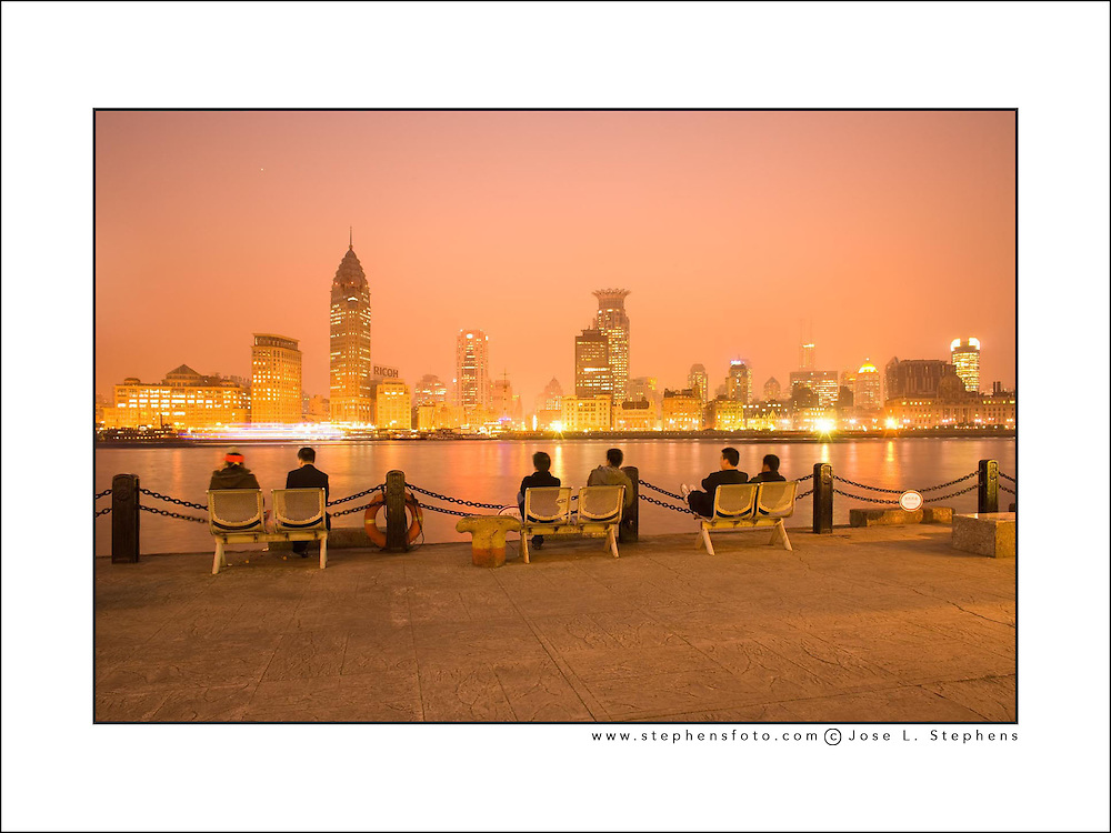 People watching The Bund skyline across the Huangpu river from Pudong, Shanghai, China, Asia