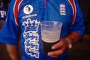 A cricket fan enjoys a pint and a day out during the test match between England and New Zealand on 21st August 1999, at the Oval ground, south London, England.