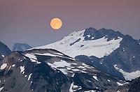 Full moon rising over Mount Challenger, North Cascades National Park Washington