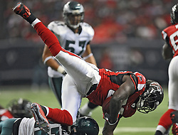 ATLANTA - DECEMBER 6: Running back Jerious Norwood #32 of the Atlanta Falcons gets upended by cornerback Asante Samuel #22 of the Philadelphia Eagles on December 6, 2009 at Georgia Dome in Atlanta, Georgia. The Eagles won 34-7.(Photo by Drew Hallowell/Getty Images)  *** Local Caption *** Jerious Norwood;Asante Samuel