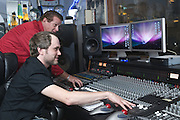 """Tyler Morrison, seated, and Wise """"Doc"""" Smith at an older 96-channel analog mixing table in the control room, Thursday, July 26, 2012, at Liquid Sound Studios in Greenville, Ind. (Photo by Brian Bohannon)"""
