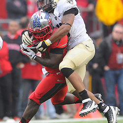 10 November 2012: Army Black Knights linebacker Geoffery Bacon (6) leaps on and tackles Rutgers Scarlet Knights running back Jawan Jamison (23) during NCAA college football action between the Rutgers Scarlet Knights and Army Black Knights at High Point Solutions Stadium in Piscataway, N.J.. Rutgers defeated Army 28-7.