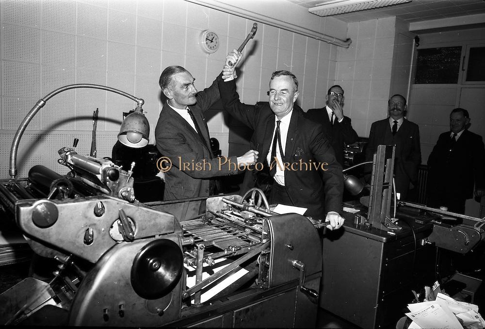 14/05/1965<br /> 05/14/1965<br /> 14 May 1965<br /> Irish Shell staff presentation at offices on Fleet Street, Dublin. Retiring Member of staff attacking workstation!