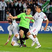 Konyaspor's Erdal KILICASLAN (C) and Karsiyakaspor's Ercag EVIRGEN (R) during their Play Off Second leg match at AliSamiYen Stadium in Istanbul Turkey on Thursday, 20 May 2010. Photo by TURKPIX