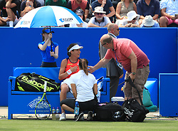 Great Britain's Johanna Konta speaks with the tournament doctors during her match with Ukraine's Lesia Tsurenko during day two of the 2017 AEGON Classic at Edgbaston Priory, Birmingham.