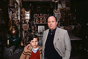 Antique dealer and son in front of his shop in Seville, Spain.
