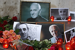 October 2, 2018 - Kiev, Ukraine - Flowers and candles are seen in tribute to late French singer and actor CHARLES AZNAVOUR in front of the French Embassy in Kiev, Ukraine, 02 October 2018. Charles Aznavour has died aged 94 in his house on 01 October 2018. (Credit Image: © Serg Glovny/ZUMA Wire)