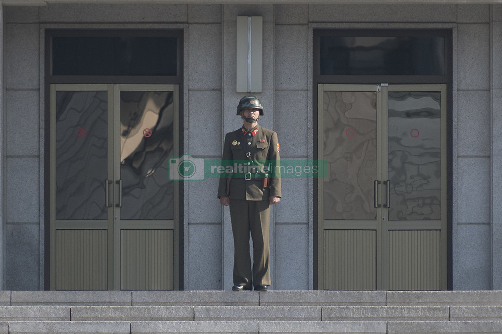 October 13, 2017 - Panmunjom, South Korea - A North Korean soldier stands guard in the border village of Panmunjom between South and North Korea at the Demilitarized Zone (DMZ) on October 14, 2017 in Panmunjom, South Korea. North Korea renewed its threats to launch ballistic missiles around the U.S. Territory of Guam. (Credit Image: © Yichuan Cao/NurPhoto via ZUMA Press)