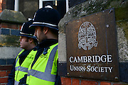 © Licensed to London News Pictures. 19/02/2013. Cambridge, UK. Police guard an entrance. Unite Against Fascism holds a demonstration and Rally today,19th February, outside the Cambridge Union debating society, against Marine Le Pen who has been invited to address the Union. Marine Le Pen is the President of the Front National, the third largest political party in France.  As a long-standing MEP, she has become a highly influential figure on the European right . Photo credit : Stephen Simpson/LNP