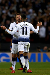October 3, 2018 - London, England, United Kingdom - Harry Kane of Tottenham celebrates goal with teammate Erik Lamela of Tottenham during the Group B match of the UEFA Champions League between Tottenham Hotspurs and FC Barcelona at Wembley Stadium on October 03, 2018 in London, England. (Credit Image: © Jose Breton/NurPhoto/ZUMA Press)
