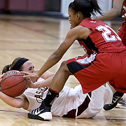Ashley's Brittany Butts battles for a loose ball with 71st's Ambryia Davis. (Jason A. Frizzelle)
