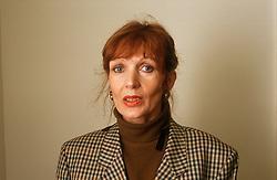 Portrait of woman wearing tweed jacket,