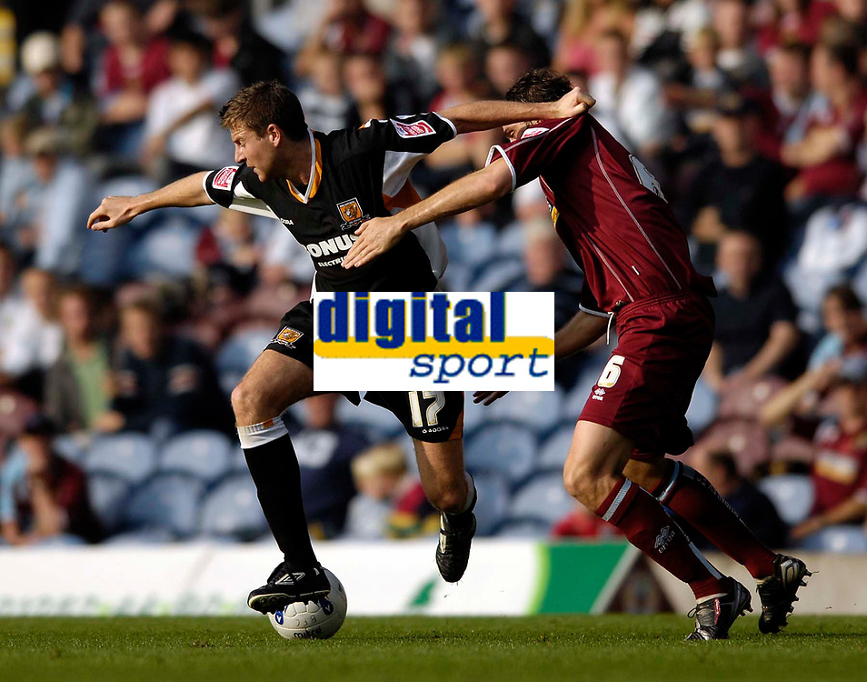 Photo: Jed Wee.<br />Burnley v Hull. Coca Cola Championship. 14/10/2006.<br /><br />Hull's Michael Bridges (L) keeps Burnley's Michael Duff at arm's length.