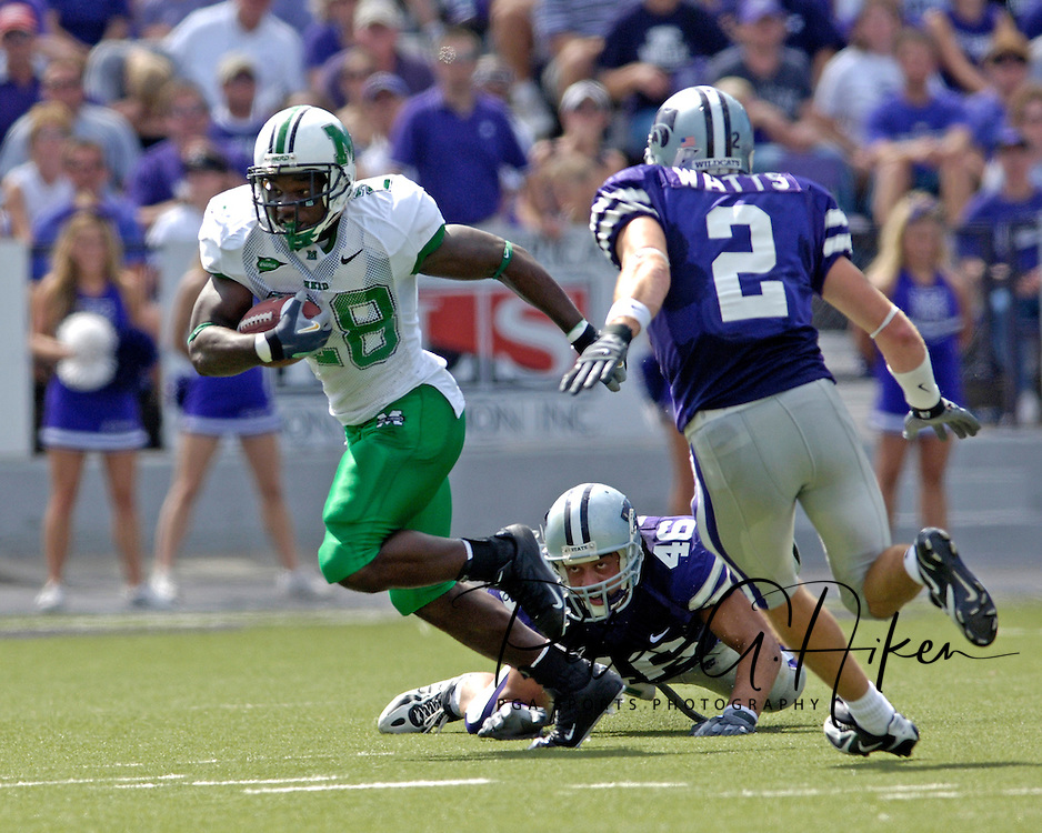 Marshall running back Chubb Small (28) splits Kansas State defenders Brandon Archer (46) and Marcus Watts (2) in the first half, at Bill Snyder Family Stadium in Manhattan, Kansas, September 16, 2006.  The Wildcats beat the Thundering Herd 23-7.