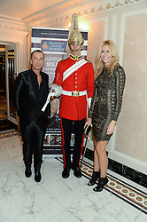 JULIEN MACDONALD and MELISSA ODABASH with soldier at Fashion For The Brave at The Dorchester, Park Lane, London on 8th November 2013.