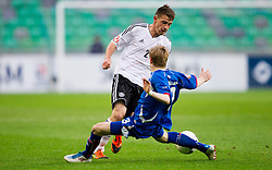 Pascal Itter of Germany vs Osvald Jarl Traustason of Iceland during the UEFA European Under-17 Championship Group A match between Iceland and Germany on May 7, 2012 in SRC Stozice, Ljubljana, Slovenia. Germany defeated Iceland 1-0. (Photo by Vid Ponikvar / Sportida.com)